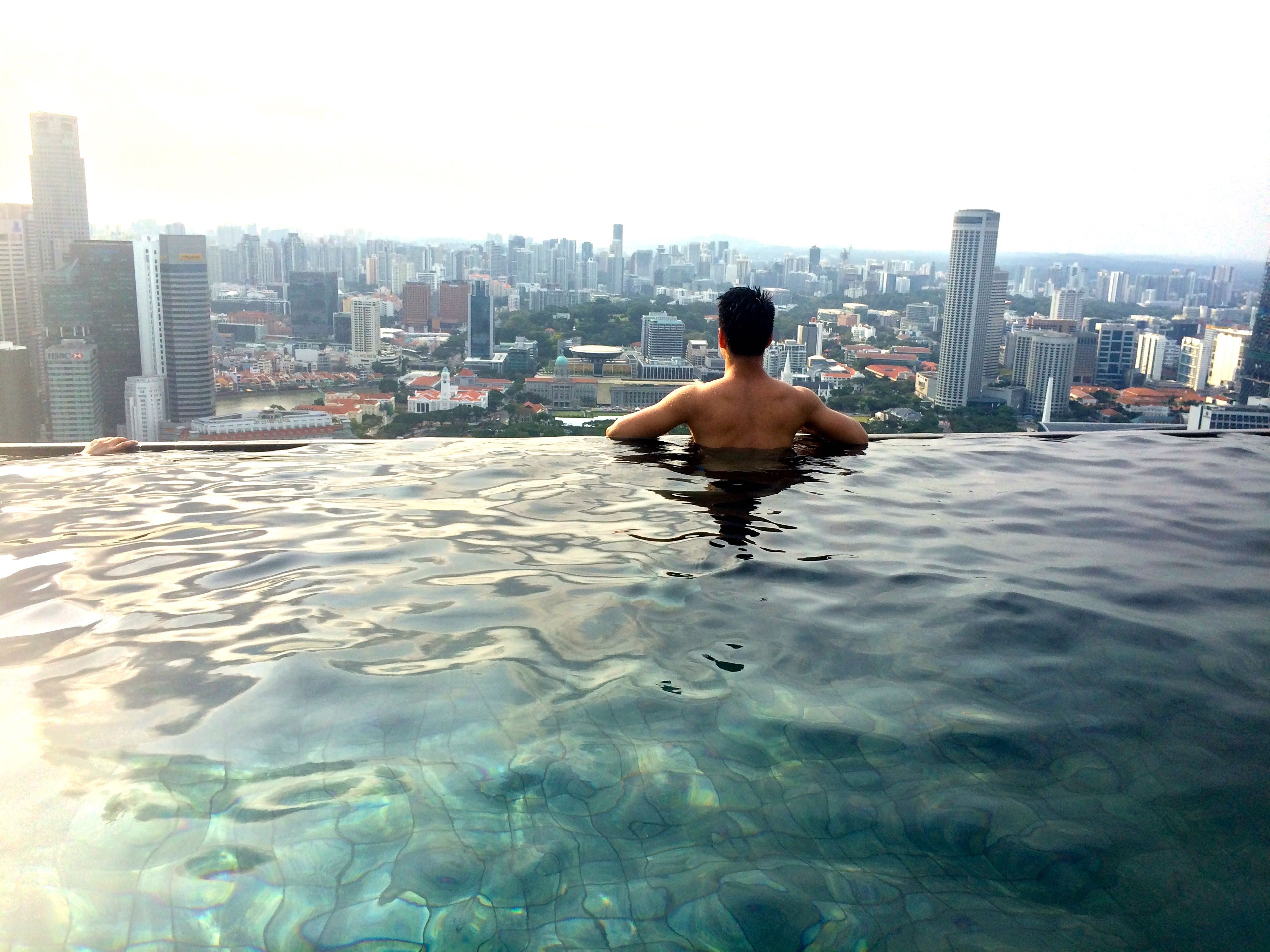 Bucket list 1 go swimming at the edge of marina bay sands infinity pool hubert cu for Gay in singapore swimming pools
